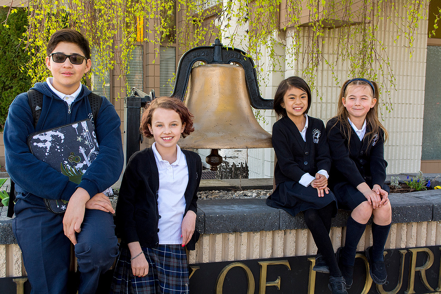 Students by the big bell.
